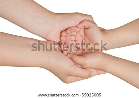 Daughter holds the hand of the mother - stock photo