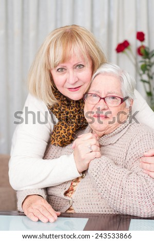 Daughter hugging her mother with affection - stock photo