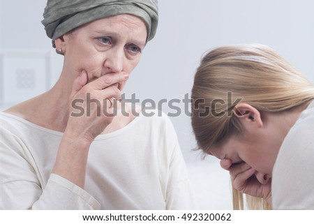 Daughter listening to her mother talking about an illness