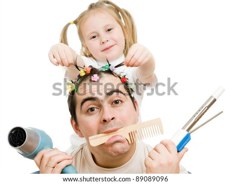 Daughter of braids cornrows his father on a white background. - stock photo