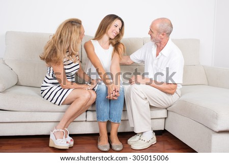 Daughter talking with parents  - stock photo