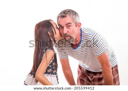Daughter telling dad a secret, whispering in his ear - stock photo