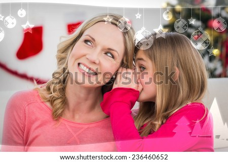 Daughter telling her mother a christmas secret against christmas themed frame - stock photo