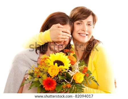 daughter with hand in front of mothers face - stock photo