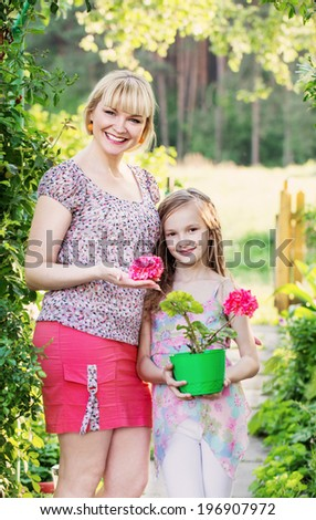 daughter with her mother in the summer garden