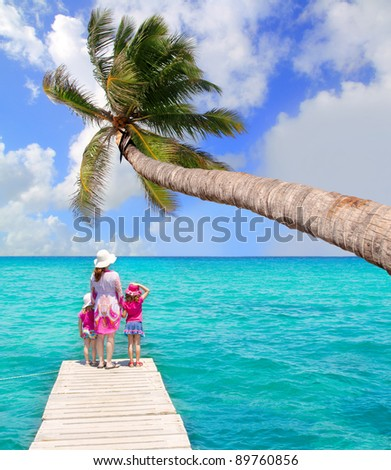 Daughters and mother in jetty at tropical turquoise sea [Photo Illustration] - stock photo