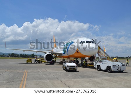 DAVAO, PHILIPPINES - APRIL 19, 2015: Cebu Pacific aircraft at Davao International Airport. Cebu Pacific is one of the most popular Filipino flying agencies in the Philippines.