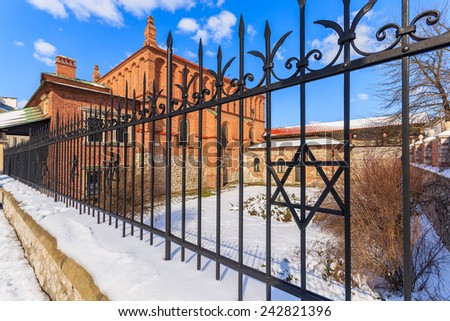 David star on fence of old Jewish synagogue in Kazimierz district of Krakow city, Poland - stock photo