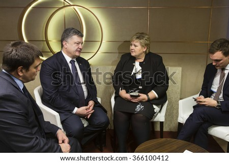 DAVOS, SWITZERLAND - Jan 21, 2016: President of Ukraine Petro Poroshenko and Norwegian Prime Minister Erna Solberg during the meeting in Davos (Switzerland)