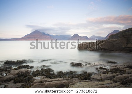 dawn at Elgol beach overlooking sea and mountains, isle of Skye, Scotland  - stock photo