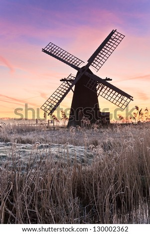 Dawn at Herringfleet mill on a frosty winters morning - stock photo