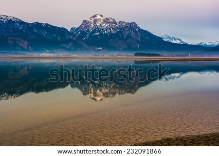 dawn at lake Forggensee in the Alps of Bavaria