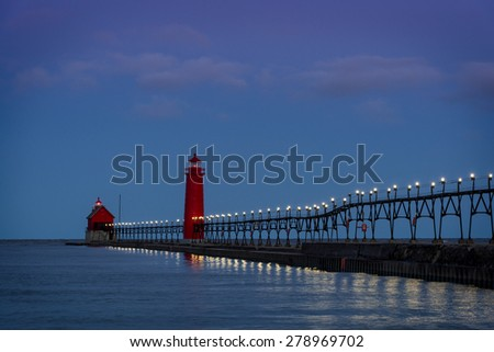 Dawn at the Grand Haven South Pierhead Inner Light with Entrance Light in background in Grand Haven State Park in Grand Haven, Michigan - stock photo