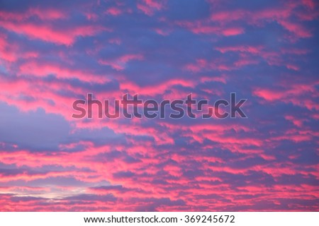 Dawn Beach Sky Rainbow Colors Morning dawn with light color rainbow reflections on the beach sands ocean waters and cirrus cloud sky for a moment in nature - stock photo