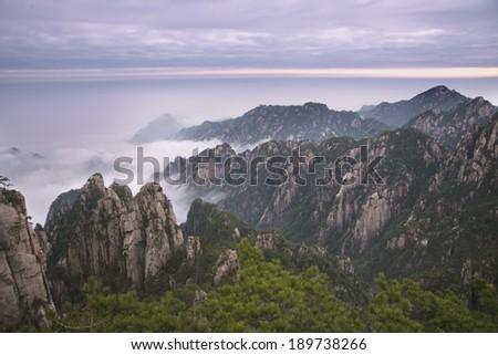 Dawn breaking over Yellow Mountain, Mt. Huangshan - stock photo