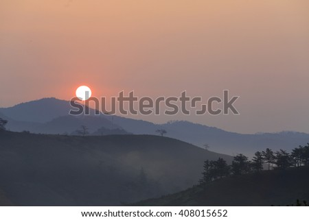 Dawn coming in top of mountain . Beauty world - stock photo