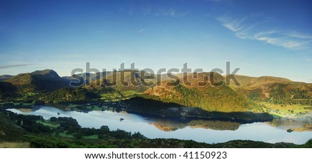 Dawn light over Ullswater and the Helvellyn range in the English Lake District. Taken from Place Fell - stock photo