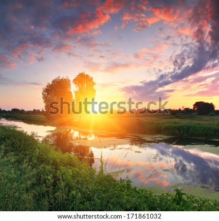 Dawn on the river bank - stock photo