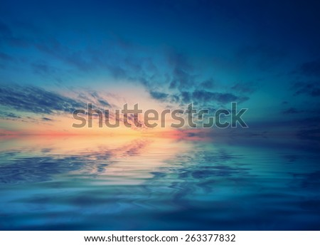 Dawn over the calm Black sea and small waves. Romantic mood transmitted color palette pictures