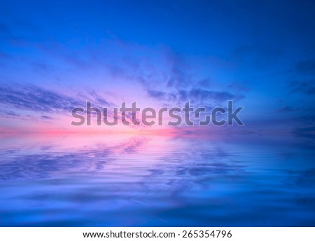 Dawn over the calm sea.  - stock photo