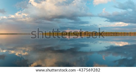 Dawn pants, rising sun lights above Kama river in Pazdery, Udmurtia, Russia - stock photo