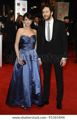 Dawn Porter and Chris O'Dowd arriving for the BAFTA Film Awards 2012 at the Royal Opera House, Covent Garden, London. 12/02/2012  Picture by: Steve Vas / Featureflash