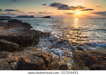 Dawn sunrise landscape over beautiful rocky coastline in Mediterranean Sea - stock photo
