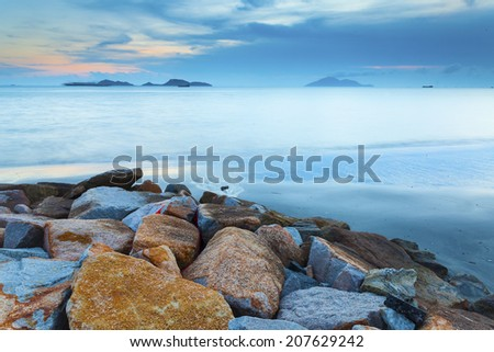 Dawn sunset landscape over beautiful rocky coastline - stock photo