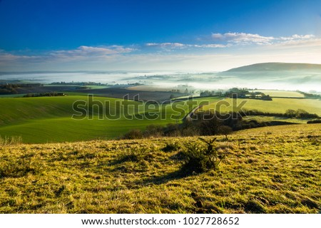 Dawn with the sun rising over the Sussex Weald and the South Downs in East Sussex South east England mid February