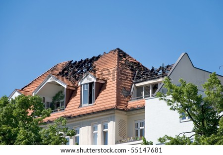 day after a big fire in a roof of a house - stock photo