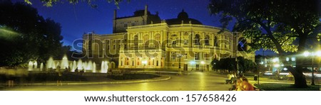 Day and dark night Odessa National Academic Theater of Opera and Ballet beauty and a symbol of the port city, a bright big landmark, tourist and cultural center of the city on the background Black Sea - stock photo
