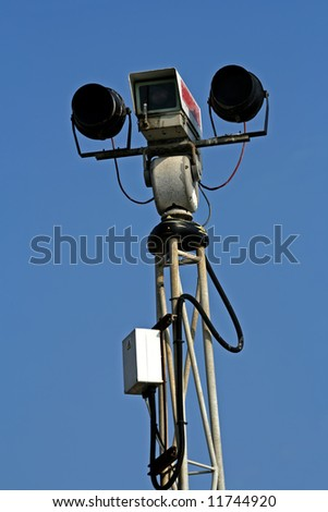 day and night security camera on top of pole - stock photo