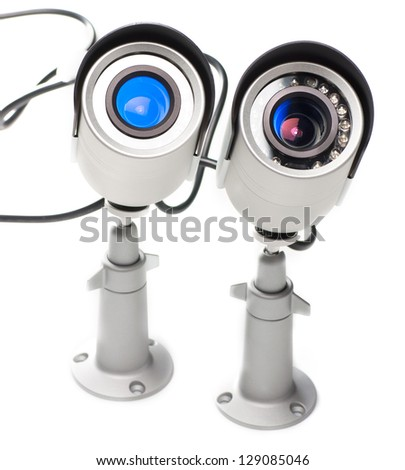 Day & Night Color surveillance video camera isolated on white background.