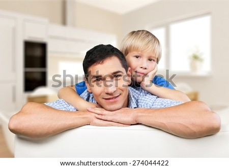 Day. Portrait Of Happy Father Carrying His Son A Piggyback Ride - stock photo