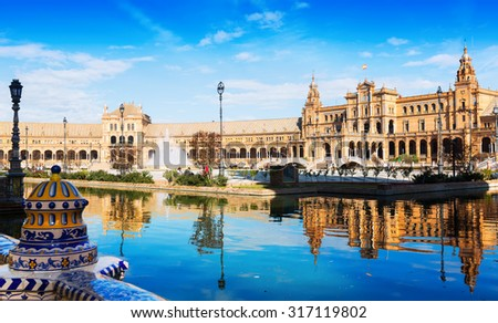 Day sunny view of Plaza de Espana with reflection. Seville, Spain - stock photo