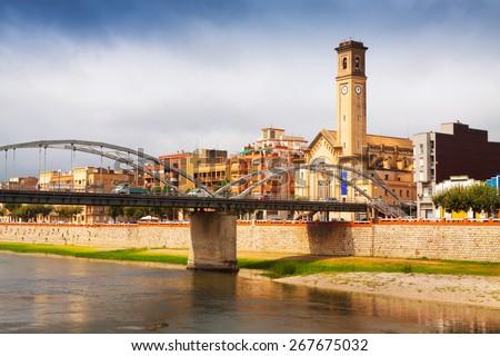 Day view of Bridge called Pont de l'Estat over Ebro river in Tortosa, Spain - stock photo