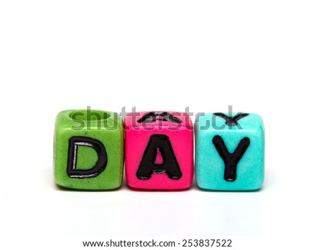 day - word made from multicolored child toy cubes with letters  - stock photo