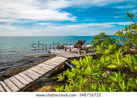 Daybed chairs in beautiful tropical island rock beach - Koh Kood, Trat Thailand