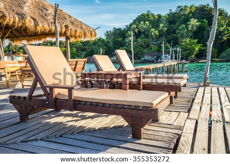 Daybed chairs in beautiful tropical island rock beach - Koh Mak, Trat Thailand - stock photo
