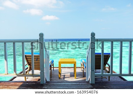 Daybed in Water Villas (Bungalows) on the Perfect Tropical Island, Maldives - stock photo