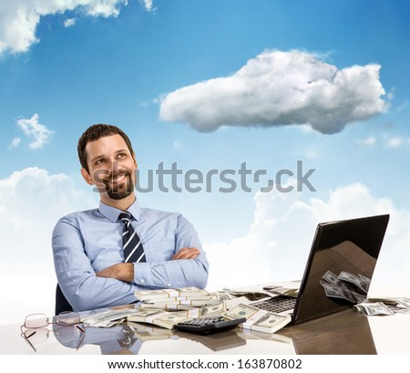 Daydreaming businessman with arms crossed / cheerful and successful businessman smile day dreaming with his arms crossed sitting at his desk with laptop and a lot of money  - stock photo