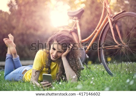 Daydreaming girl at the park - stock photo