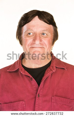 Daydreaming middle aged man in red shirt
