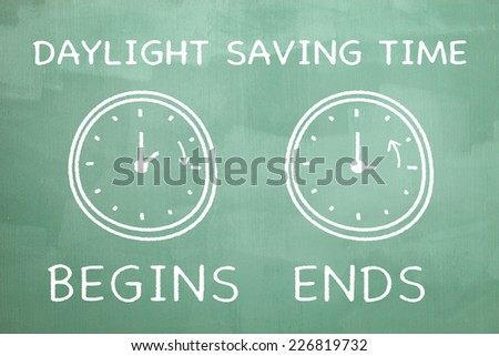 Daylight saving time illustration drawn on a chalkboard to indicate the end of the daylight saving time.  - stock photo