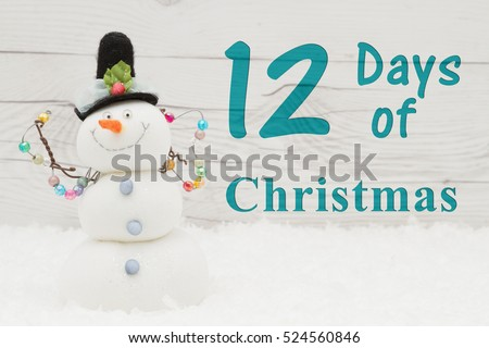 Days of Christmas message, Some snow and a snowman on weathered wood with text 12 Days of Christmas
