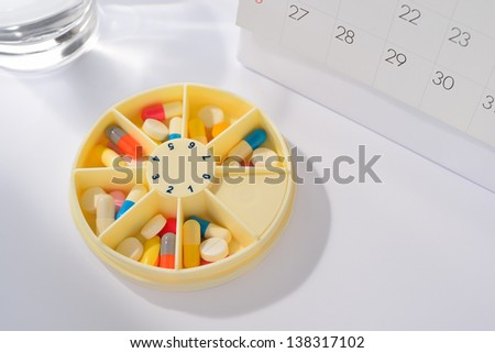 Days of the week pill box - stock photo