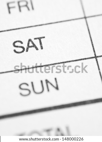 Days of the week: SATURDAY. White paper form close up. - stock photo