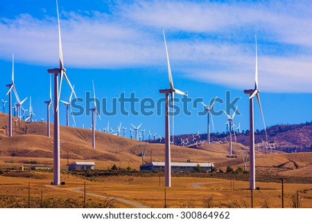 Daytime picture of an Electricity Windfarm - stock photo