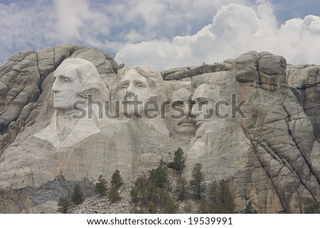 Daytime shot of Mount Rushmore with the presidents heads. - stock photo