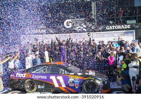 Daytona Beach, FL - Feb 21, 2016: Denny Hamlin celebrates his win in Victory Lane  during the Daytona 500 weekend at the Daytona International Speedway in Daytona Beach, FL. - stock photo